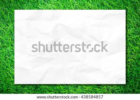 Paper background for design. Crumpled white paper on green grass background. Blank paper texture. Paper empty page. Paper background white copy space for text or image. - stock photo