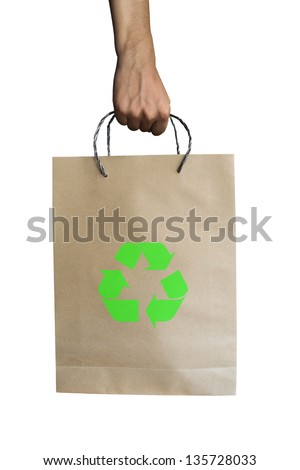 Paper bag and recycle symbol with hand - stock photo