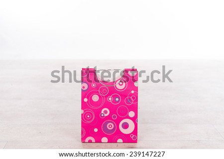 paper bag in pink for wrapping a present  - stock photo