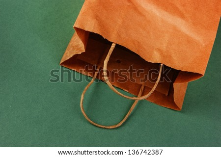 paper bag on a green background - stock photo
