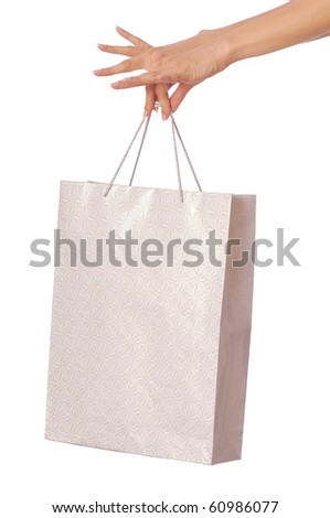Paper bag with a rose from the supermarket - stock photo