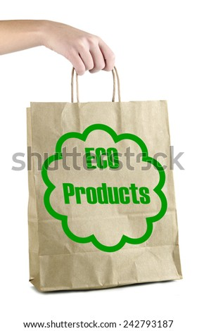 Paper bag with eco products in hand isolated on white - stock photo