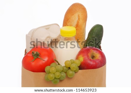 Paper bag with food isolated on white background - stock photo