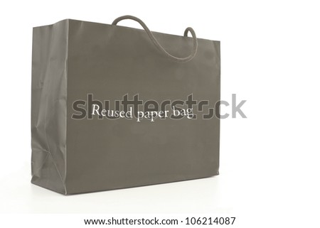 Paper bag with reused paper bag tag isolated on white background - stock photo