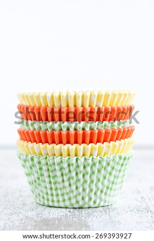 paper baking cups for cupcakes and muffins - stock photo