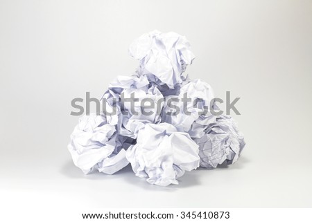 paper balls on gray background - stock photo