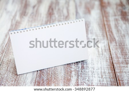 paper banner isolated on a wooden background - stock photo