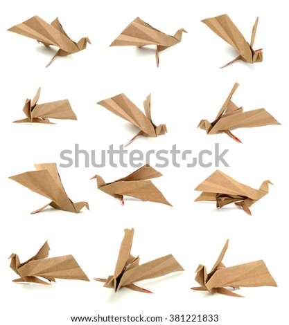 Paper birds on white background - stock photo