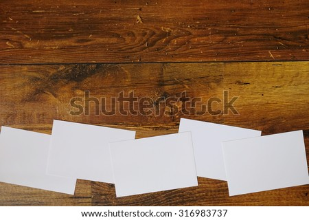Paper blank photos collage on wooden background. Preparation for a photo collage. Postcards on the table. - stock photo