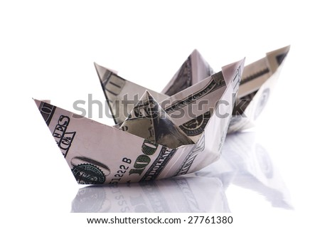 paper boats from dollars banknote on white - stock photo
