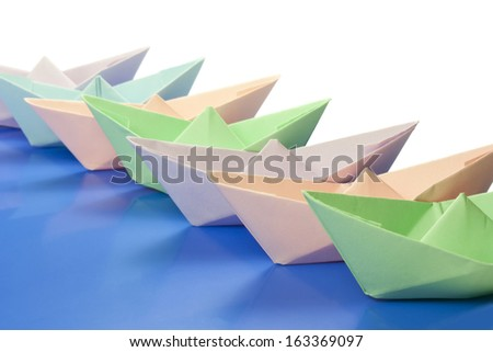 paper boats go in colors - stock photo