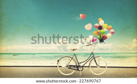 Paper Card of bicycle vintage with heart balloon on beach blue sky concept of love in summer and wedding honeymoon - stock photo