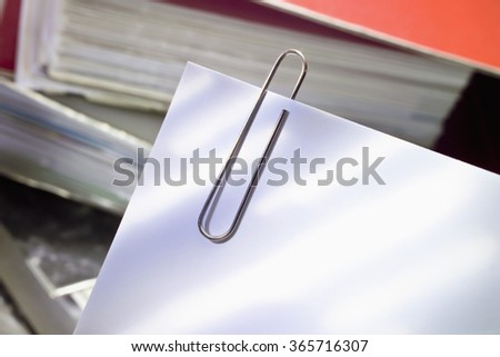 Paper clip and paper goods - stock photo