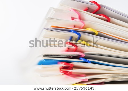 Paper clips.Colorful clips and Stack of papers paperwork. - stock photo