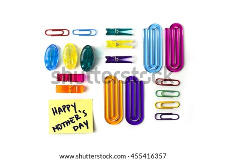 Paper clips set and yellow paper note with the words Happy Mothers Day isolated over a white background - stock photo