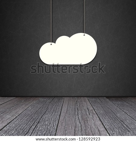 Paper cloud hanging on the rope on Blackboard background - stock photo