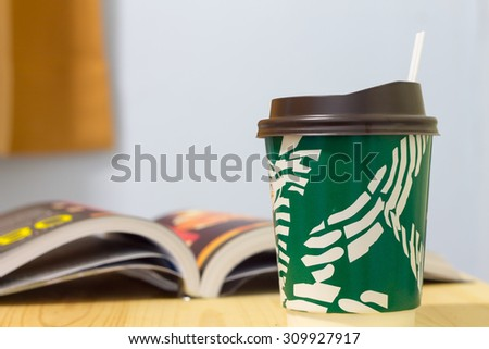 paper coffee cup on wood table - stock photo