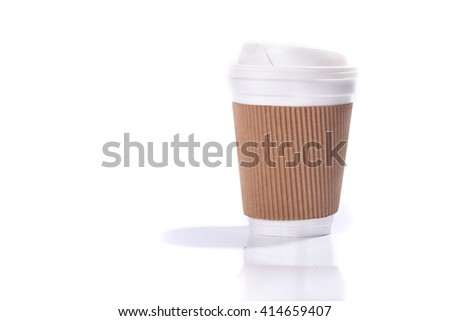 Paper coffee cup with sleeve, isolated on white background - stock photo