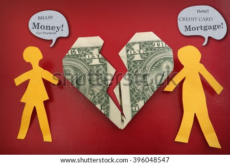 Paper couple fighting about money, with broken dollar heart                         - stock photo