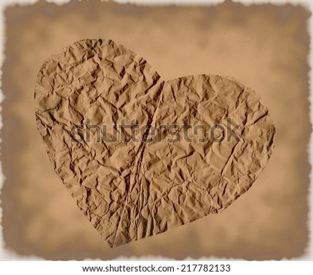 Paper crumpled heart on grunge background - stock photo