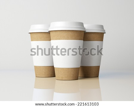 Paper cups on grey background.  - stock photo