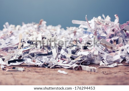 Paper cut into tiny pieces by cross shredder - stock photo