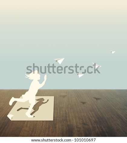 Paper cut of child on wood table - stock photo