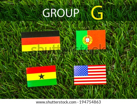Paper cut of flags on grass for Soccer championship 2014 , group G - stock photo