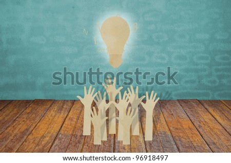 Paper cut of Hands volunteering or voting and light bulb - stock photo
