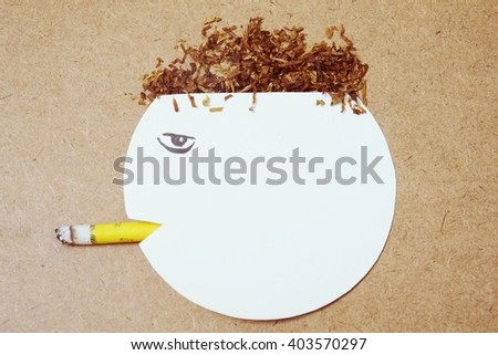 paper cut of head destroyed by  cigarette  - stock photo