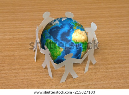 Paper cut of people standing in a circle around globe on wooden floor (Elements of this image furnished by NASA) - stock photo