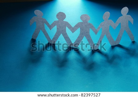 Paper cut people, isolated on blue background - stock photo