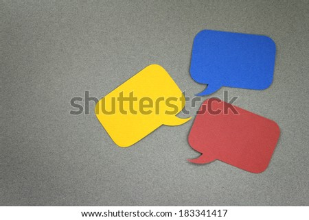 Paper dialog boxes on gray background with blank empty copy space - stock photo