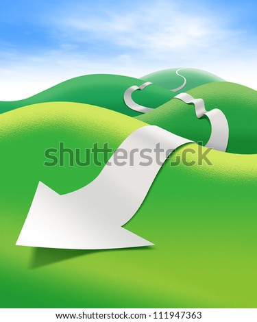 Paper direction arrow on green field - stock photo