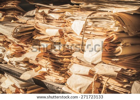 Paper documents stacked in archive in closeup - stock photo