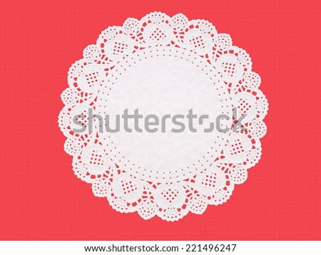 Paper doily on textured red. Celebration background. - stock photo