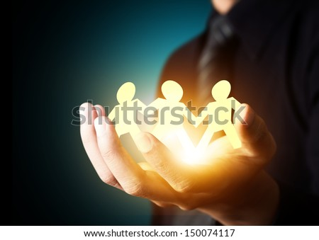 Paper family in hand, insurance concept - stock photo