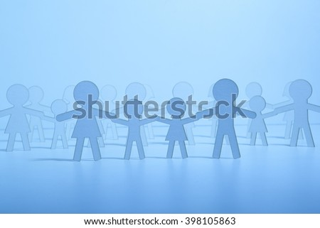 Paper family on blue background. Blue Light - stock photo
