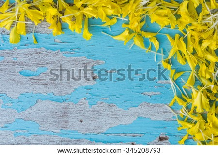 Paper flower or Mari gold decorated on grunge blue wood background,Top view - stock photo