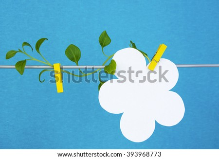 paper flower sticker with petunia green lineon a rope. concept - information, reminder, note, sowing table, love letter - stock photo