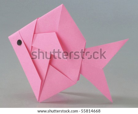 Paper folded into a fish. - stock photo