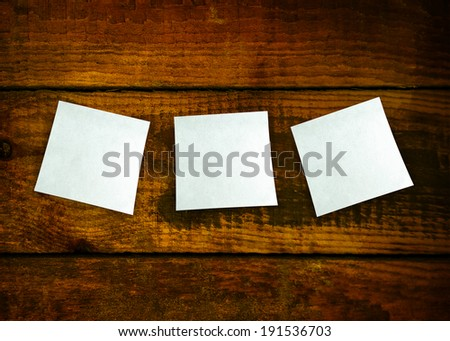 Paper frames on wooden texture - stock photo