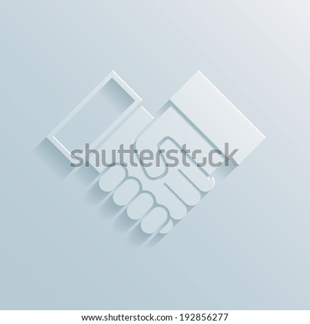 Paper handshake icon depicting a business deal  agreement  partnership  greeting or congratulations - stock photo
