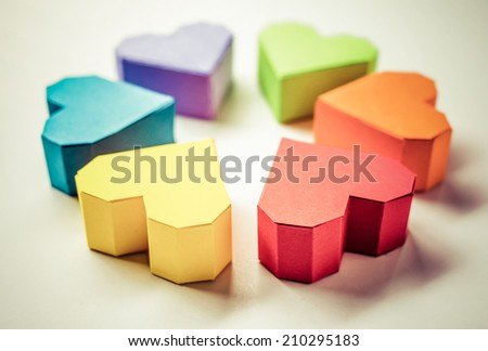 Paper hearts on white background. Toned picture - stock photo