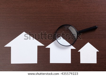 paper house with Magnifying Glass - stock photo