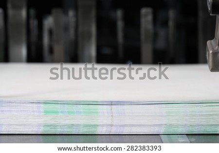 Paper in the stack in a printing press - stock photo