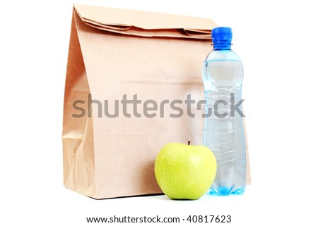 paper lunch bag with fresh apple and water on white - food and drink - stock photo
