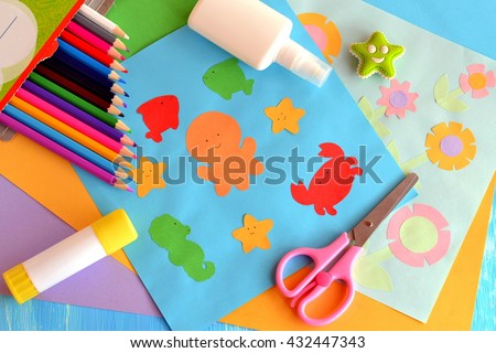 Paper marine animals and flowers cards. Glue stick, rubber, scissors, color paper, pencils. Creative and easy way to build up children imagination. Promote creative ability. Kindergarten art activity  - stock photo
