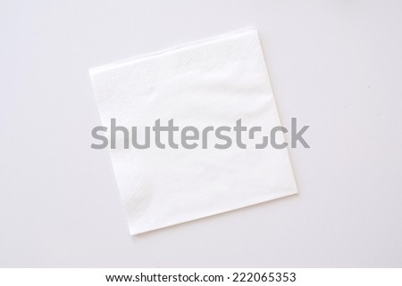 paper napkin on bright background - stock photo