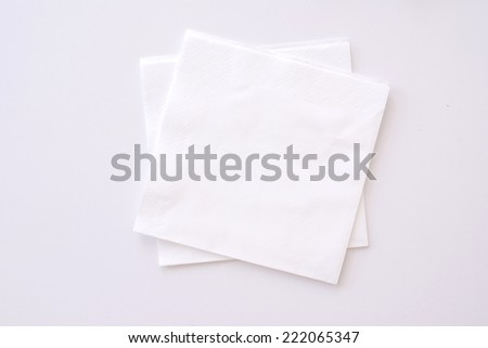 paper napkins on bright background - stock photo